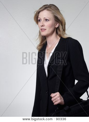 Lady Lawyer Walking Carrying A Briefcase