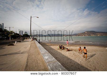 Unidentified people enjoying the beach in Bahia de Caraquez city, Ecuador