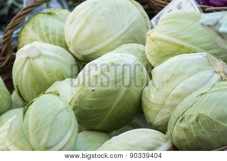 Fresh Organic Vegetables - Pile Of Cabbages In A Basket At A Farmer's Market