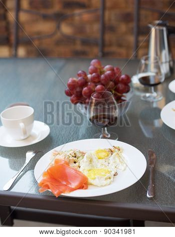 Coffee, cognac and scrambled eggs breakfast