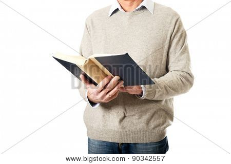 Mature male hands holding a book.