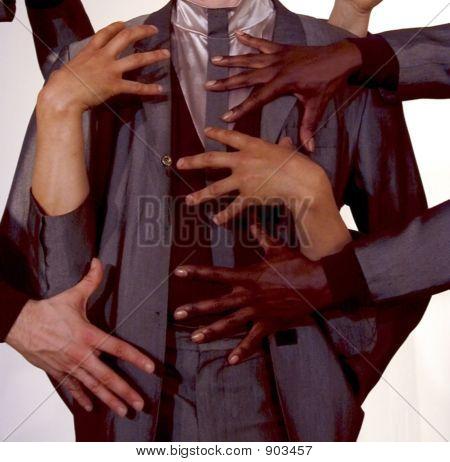 Hands Groping Man In A Suit