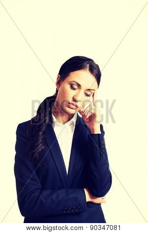 Businesswoman tired because of troubles holding her head.