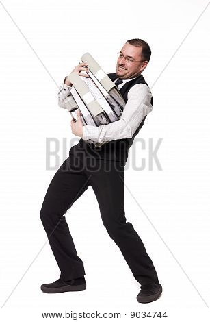 Man with pile of folders