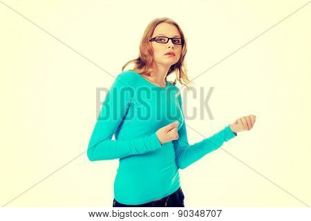 Frustrated teenage woman making fists