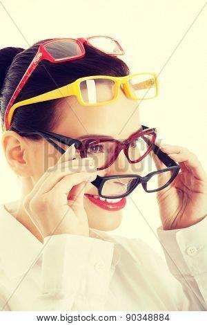 Portrait of a woman wearing many eyewear.