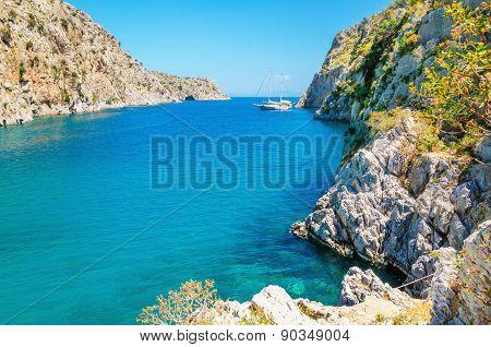 Sea bay on Greek Island with yacht achored, Greece