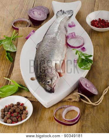 Raw Rainbow Trouts On   Rustic Wooden Table