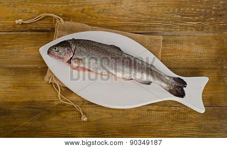 Rainbow Trouts On A White Cutting Board.