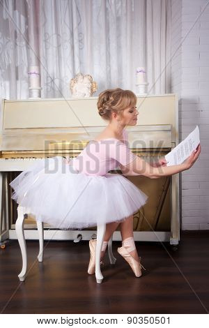 Pretty Ballerina With Notes In Her Hands