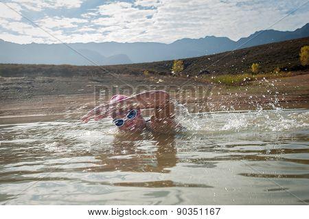 Female Swimmer In A Dam
