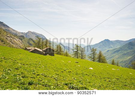 Alpine Stone Huts In Amazing Green Scenery