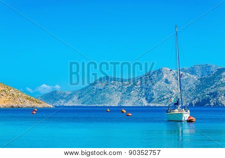 Sport yacht on anchor in bay of Greek Island