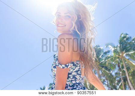 young happy girl with flower bouquet on tropical sea and beach background, smiling happy girl outdoor portrait