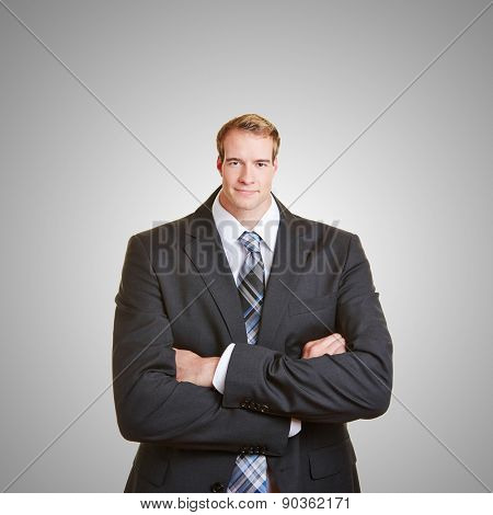 Funny business man with a small head and his arms crossed
