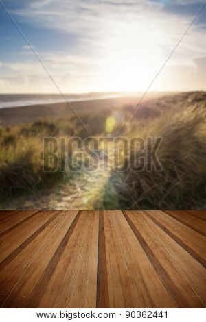 Blue Sky Summer Beach Landscape With Lens Flare Filter Effect With Wooden Planks Floor