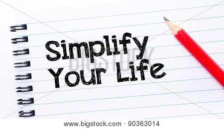 Simplify Your Life Text Written On Notebook Page