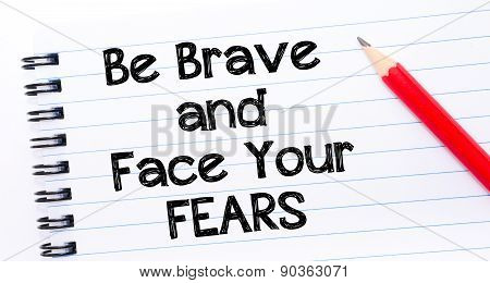 Be Brave And Face Your Fears Text Written On Notebook Page