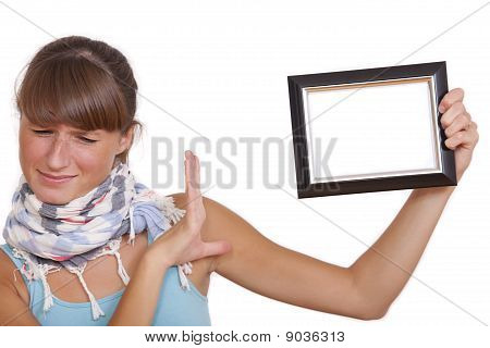Unhappy Woman With Photo Frame