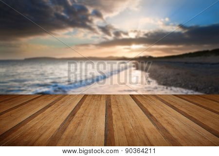 View Along Coast Into Beautiful Setting Sun With Wooden Planks Floor