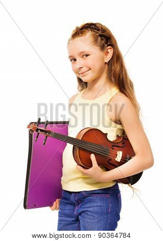 Small girl holding purple folder and violin