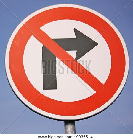 No right turn traffic sign against blue sky