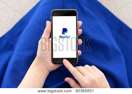 Woman Holding Iphone 6 With Paypal On The Screen