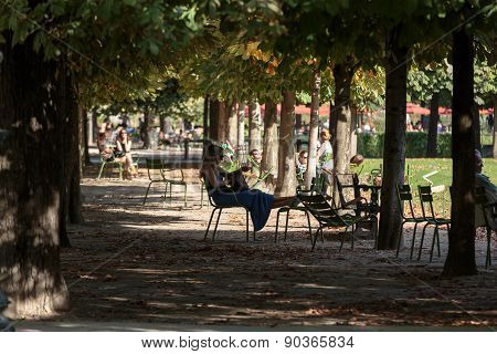Paris - Local and Tourist in famous Tuileries garden.