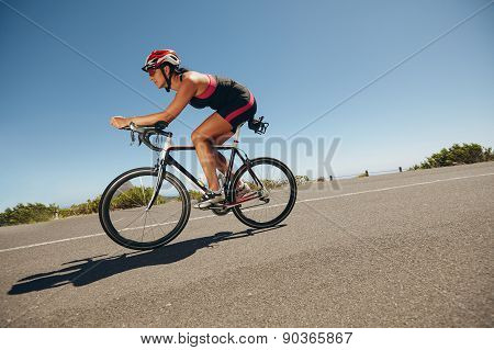 Female Cyclist On A Country Road