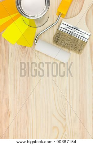 Paint Roller, Brush And Paint Can With Color Samples