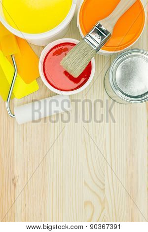 Painting Tools And Color Guide On Wooden Background