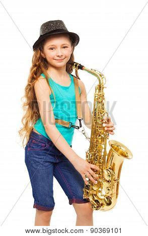 Girl wearing hat and playing alto saxophone