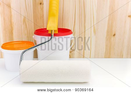 Paint Roller With Cans Of Paint