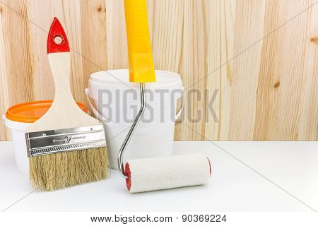 Painting Tools And Accessories Against Wooden Background