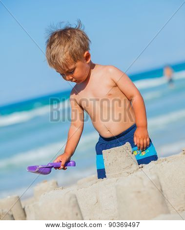 Boy plaing on the beach