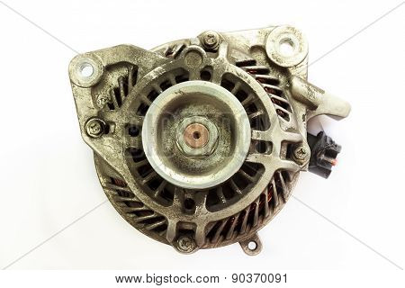 Dirty And Old Automotive Alternator, Closeup On White Background