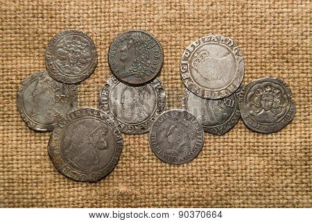 Ancient England Silver Coins With Portraits Of Kings On The Old Cloth