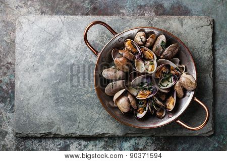 Shells Vongole Venus Clams In Copper Cooking Dish On Stone Slate Background