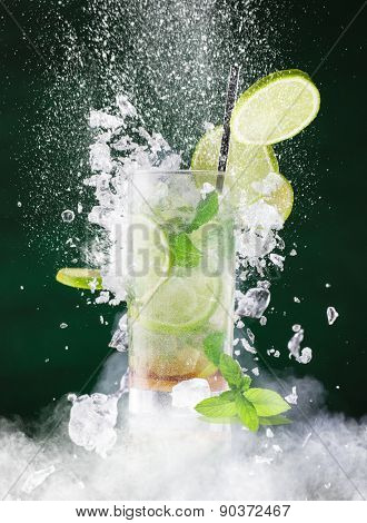 fresh mojito drink with liquid splash, freeze motion.