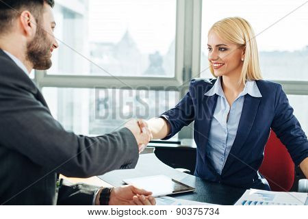 Businesswoman And Businessman Handshake In The Office