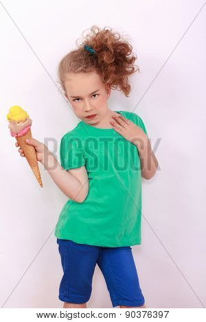 Young blond girl with ice-cream cone in the hand