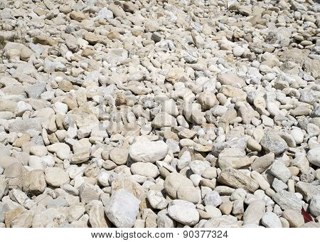 Pile Rounded Stones On The Beach