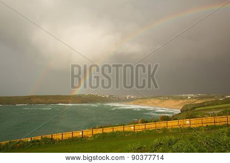 Rainbow at Crantock beach in Cornwall England UK