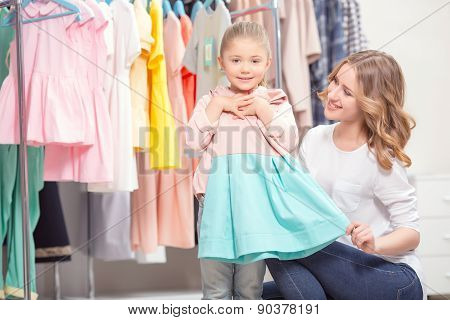 Mother goes shopping with her daughter