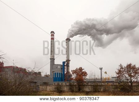 Factory, two smoking chimneys