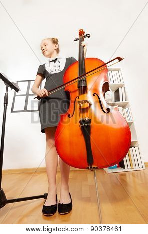 View from below of girl playing violoncello