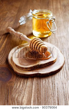 Wooden Dipper With Honey