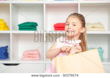 Portrait of small girl in a fashion store