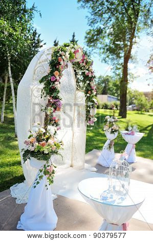 Decorated Archway For Wedding Ceremony With Colorful Flowers
