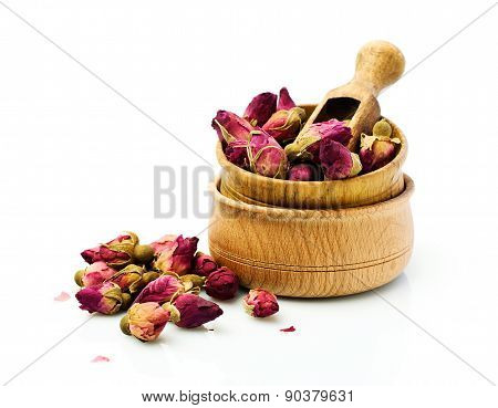 Buds Of Dried Roses For Tea In A Wooden Bowl